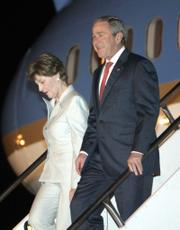 President Bush and first lady Laura Bush arrive Thursday at Guarulhos International Airport in Sao Paulo, Brazil.