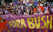 "Activists carry a banner that reads ""Get out Bush"" during a protest march Thursday against President Bush in Sao Paulo, Brazil. Bush is on a five-country Latin American visit."
