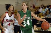Free State's Jenna Brantley (24) drive the perimeter against Wichita Heights' Jennifer Lane on Friday in Emporia.