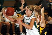 Free State's Jenna Brantley reaches for a loose ball against Shawnee Mission West's Kaitly Biehl.