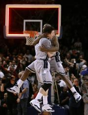 Georgetown's Jessie Sapp, left, and Jeremiah Rivers celebrate as the final buzzer sounds. The ninth-ranked Hoyas edged No. 20 Notre Dame, 84-82, Friday in New York.