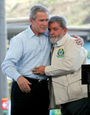President Bush and Brazilian President Luiz Inacio Lula da Silva embrace Friday after a joint statement at a Petrobras fuel distribution center in Guarulhos.