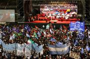 Thousands attend a rally against the ongoing visit to several Latin American countries by President Bush on Friday at the Ferrocarril Oeste stadium in Buenos Aires, Argentina. The demonstration was attended by Venezuela's President Hugo Chavez.