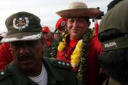 Venezuela's President Hugo Chavez wears a traditional hat during a visit to Trinidad, Bolivia. Chavez's counter-Bush tour reached flood-ravaged Bolivia on Saturday, following up on millions of dollars in aid the leftist leader has pledged to cope with months of deadly flooding in its eastern lowlands.