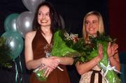 Margaret Perkins-McGuinness, left, smiles as she is named St. Patrick's Day Parade queen, while fellow contestant Kassie Baxtor applauds. Perkins-McGuinness was announced as this year's queen on Sunday at the Flamingo Club.