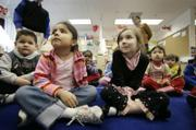 Pre-kindergarten students, from left, Jose Chavez, Danielle Moreno and Lilli Anne Morris participate in activities Thursday at Carlin Springs Elementary School in Arlington, Va.