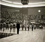 Kansas players, from left,  Maurice King, Gene Elstun, Wilt Chamberlain, John Parker and Ron Loneski stand at attention during the national anthem prior to the start of the 1957 national championship game.