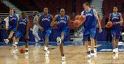 The Kansas University men's basketball team practices full-court dribbling Thursday at the United Center in Chicago. The Jayhawks will take on Niagara in the first round of the NCAA Tournament at 6:10 tonight.