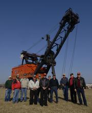 Former coal miners who worked on Big Brutus gather in front of the 16-story (160-feet tall), 11 million pounds electric shovel near West Mineral, Ks. It cost $6.5 million in 1962 and operated in southeast Kansas from 1963 to 1974.