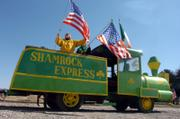 Deb Drummet, left, of Lawrence, and Caryn Becker, of Colorado Springs, Colo., put the final touches on the Shamrock Express Friday afternoon in preparation for today's St. Patrick's Day Parade, which begins at 1 p.m. in South Park and heads north on Massachusetts Street.