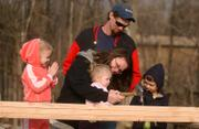 Jessica McAlister helps her daughter Riley hammer in a nail. From left, Autumn, 3, Richard Marshall and Nicholas, 7, watch during the Habitat for Humanity nail-driving ceremony.