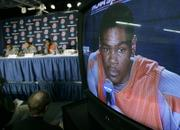 Texas forward Kevin Durant is shown on a television monitor as he talks to reporters. Durant spoke Saturday in Spokane, Wash., on the eve of today's second-round NCAA Tournament game against Southern Cal.