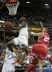 UCLA's Darren Collison goes up for a basket against Indiana's A.J. Ratliff. UCLA held off Indiana, 54-49, Saturday in Sacramento, Calif. Collison led the Bruins with 15 points.