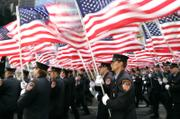 New York City firefighters march Saturday along Fifth Avenue during the St. Patrick's Day parade in New York City. The parade organizer moved the FDNY to the middle of the pack this year, instead of its usual position in the front.