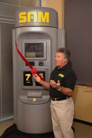 Racing legend Mario Andretti is helping launch Smart Auto Management LLC's new self-service automotive diagnostic kiosk, called SAM. The unit allows drivers to plug a device into a port found in all 1996 and newer vehicles. After running a diagnostic check of the vehicle's computers, SAM prints a list of any needed repairs.