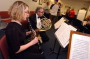Kristen Jordan and Stuart Levine, of the Lawrence Woodwind Quintet, perform at the Audio-Reader on March 4. Although the group played what it thought would be its last gig in 2003, the musicians recently started scheduling performances again.