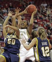BAYLOR'S DANIELLE WILSON (11) battles with Chattanooga's Shanara Hollinquest (50) and Brooke Hand (12) during their NCAA Tournament game in Raleigh, N.C. The fifth-seeded Bears won Sunday's contest, 68-55.