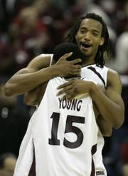 Southern Illinois' Randal Falker and Tony Young (15) celebrate their 63-48 over Virginia Tech on Sunday in Columbus, Ohio, earning a Sweet 16 meeting with Kansas University.