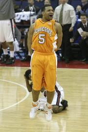 Tennessee guard Chris Lofton (5) celebrates at the final buzzer in front of Virginia's Sean Singletary. Singeltary's last-second three-point attempt bricked, giving the Volunteers a 77-74 victory Sunday in Columbus, Ohio.