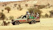 A Darfur rebel unit patrols in Anka, Sudan Tuesday, Feb. 20. Though the government says rebels are cornered in a small patch of desert, rebels give the impression they master vast expanses of Darfur - travelling and fighting on pickup trucks, known locally as technicals.