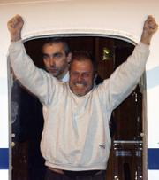 Daniele Mastrogiacomo, a reporter for Italian daily newspaper La Repubblica, arrives at Ciampino military airport Tuesday. Mastrogiacomo was kidnapped in Afghanistan by the Taliban two weeks ago and was released Monday.