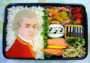 Junko Terashima shows an edible likeness of Mozart in a box lunch she prepared for her child. The intricate presentations are a public way for Japanese mothers - who often forego careers to cater to their families - to demonstrate their devotion to motherhood, dedication to their children's nutrition and creative skills.