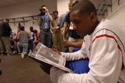 Kansas University's Mario Chalmers studies the Southern Illinois media guide. The Jayhawks fielded questions from the media - many about SIU's vaunted defense - Wednesday in the HP Pavilion in San Jose, Calif.