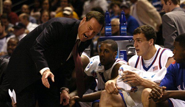 Kansas head coach Bill Self rips into center Sasha Kaun for his defensive play during the first half of Thursday's game against the Salukis at the HP Pavillion in San Jose. Left of center is guard Mario Chalmers and right is guard Rodrick Stewart.