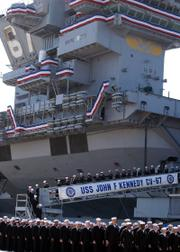 "sailors take their final walk down the brow of the USS John F. Kennedy during the ship&squot;s decommissioning ceremony in Mayport, Fla. Sailors in blue lined the deck of the aircraft carrier on Friday as guns boomed to commemorate the decommissioning of ""Big John"" after nearly 40 years of service."