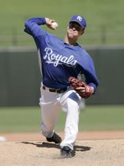 Kansas City pitcher Zack Greinke delivers against the Brewers. Greinke struck out seven in five innings.