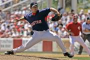 Boston pitcher Daisuke Matsuzaka delivers against the Cincinnati Reds. Matsuzaka threw five hitless innings Monday in Sarasota, Fla.