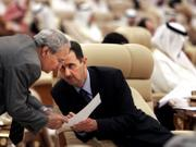 Syrian President Bashar Assad, right, talks to his vice president, Farouk al-Sharaa, during the Arab summit in Riyadh, Saudi Arabia. Arab leaders on Thursday called on Israel to accept their land-for-peace offer and open direct negotiations with the Arabs, hoping to give a new push to the long-stalled Mideast peace process.