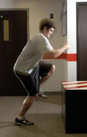 James Findley, acceleration specialist at Therapy Works, 1112 W. Sixth Street, demonstrates a plyometrics exercise.