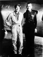 Famed aviator Amelia Earhart and her navigator, Fred Noonan, pose in front of their twin-engine Lockheed Electra in Los Angeles at the end of May 1937 before their historic flight in which Earhart was attempting to become the first female pilot to circle the globe.
