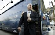 U.S. Sen. John McCain, R-Ariz., steps off his campaign bus after arriving at the Iowa Statehouse on March 15. This year's presidential candidates are driving more hybrid and flex-fuel vehicles to save energy while on the campaign trail.
