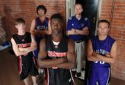 OTTAWA HIGH SENIOR VICTORY OJELEYE, CENTER, headlines this year's All-Area Boys Basketball Team. Joining Ojeleye on the first team are, from left, Ottawa junior Chase Moore, Wellsville junior Colin Wright, Baldwin coach Eric Toot - the coach of the year - and Baldwin senior Blake Wieden. Not pictured is Eudora junior Kelson Boyer.