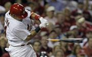St. Louis' Yadier Molina shatters his bat as he connects with the ball. The Cardinals fell to the Mets, 6-1, in the major-league baseball season opener Sunday in St. Louis.