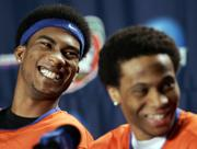 Florida's Corey Brewer, left, and teammate Taurean Green participate in a press conference Sunday in the Georgia Dome. Brewer and Green are two of the Gators' starting five, which is intact from last year's championship team.