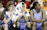North Carolina players, from left, Meghan Austin, Christina Dewitt and Iman McFarland watch the waning moments of the Tar Heels' semifinal loss. Tennessee won, 56-50, Sunday in Cleveland and advanced to Tuesday's championship game against Rutgers.