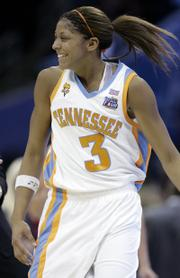 Tennessee's Candace Parker celebrates the Lady Vols' win in the women's semifinal basketball game at the Final Four Sunday in Cleveland. Tennessee will take on Rutgers in the championship game tonight.