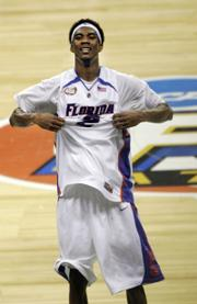 FLORIDA'S COREY BREWER pops his jersey following Monday night's 84-75 victory in Atlanta.