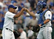 KANSAS CITY ROYALS RELIEVER JOEL PERALTA, LEFT, is congratulated by John Buck after putting the wraps on an Opening Day victory against the Boston Red Sox. The Royals earned a 7-1 triumph Monday at Kauffman Stadium in Kansas City, Mo.