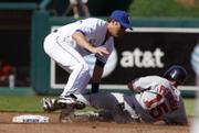 BOSTON'S DUSTIN PEDROIA IS TAGGED OUT by Kansas City second baseman Mark Grudzielanek as he tries to stretch a single into a double. The Royals knocked off the Red Sox, 7-1, in Monday's season opener at Kauffman Stadium in Kansas City, Mo.