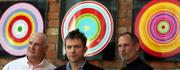 Eric Nicoli, CEO of EMI Group PLC, left, Damon Albarn, center, of the pop group Blur, and Apple Inc. CEO Steve Jobs appear together in the lobby of the EMI record company headquarters in London. Jobs was at the launch Monday of digital rights management (DRM)-free recordings that EMI will make available on the Apple iTunes Web site starting in May.
