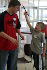 EHS student Dustin True talks with Nathan Herries about the rocket he built on Saturday.