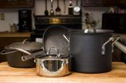 Culinary experts pretty much agree that these four pot and pans are the basics for any properly stocked kitchen. From foreground, clockwise, a 2- to 4-quart sauce pan, a 5- to 8-quart Dutch oven, a 7- to 12-inch skillet and a stockpot.