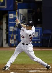 Minnesota's Justin Morneau connects for a home run. The Twins defeated Baltimore, 3-2, on Tuesday night in Minneapolis.