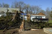 A tornado tore through a rural home at 746 E. 300 Road, taking the roof off the home and ripping apart trees in its path. Nobody was injured in the storm, which blew through a rural area southwest of Clinton Lake on Friday night.