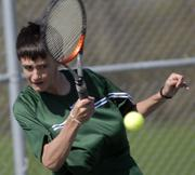 Charlie Moffet, Free State High's No. 1 singles player, returns a volley during his match with Topeka Seaman's Steven Fletcher. Moffet lost the match, 8-3, Tuesday at FSHS.