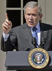 President Bush speaks at a news conference Tuesday in the Rose Garden of the White House. President Bush denounced Democrats for going on spring break without approving money for the Iraq war with no strings.